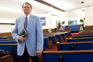 Dr. R. L. Calhoun, the Pastor of New Life Fellowship in Texas City, Texas, stands with his bible. Dr. Calhoun was one of the local religious leaders to lead the memorial service at the BP refinery after the 2005 explosion that killed 15 workers. (Lance Rosenfield/ProPublica)