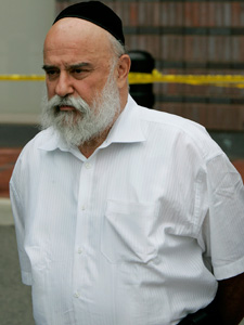 Levy Izhak Rosenbaum, of Brooklyn, N.Y., is led to a waiting bus outside FBI offices in Newark, N.J.  (Mel Evans/AP Photo)