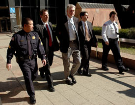 Former Worldcom CEO Bernard Ebbers is escorted from FBI offices in New York, March 3, 2004. (Reuters/Chip East)
