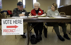 Poll workers wait for voters during the 2008 Michigan primary election in Warren, Mich. (Reuters/Rebecca Cook)