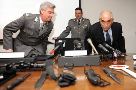 Italian anti-terrorist prosecutor Armando Spataro, pictured right, arrives for a Mar. 3, 2010, press conference announcing the arrests of Italians and Iranians suspected to have trafficked arms to Iran. (Giuseppe Cacace/Getty Images/AFP)