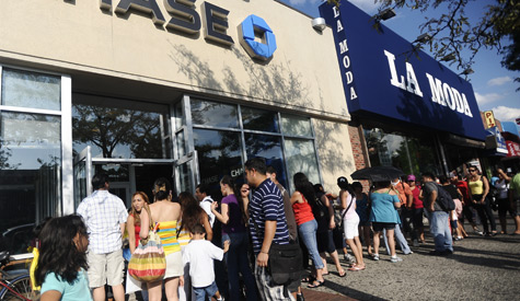 Hundreds line up outside a Chase Bank in Jackson Heights, Queens, N.Y., to take advantage of the free funds aimed at helping underprivileged children. Every child between 3 and 17 was eligible for $200. (John Taggart/New York Daily News)