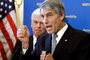 Sen. Mark Udall, D-Colo., answers a reporter's question during a news conference. (Chip Somodevilla/Getty Images)