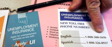 A state worker points out phone numbers for unemployment insurance at the state unemployment and career office in San Francisco. (Paul Sakuma/AP Photo)