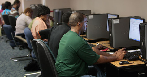 Job seekers work on computers looking for work at the New York State Labor Department's Division of Employment Services resource room on July 2, 2009 in Brooklyn, N.Y.  (Chris Hondros/Getty Images)
