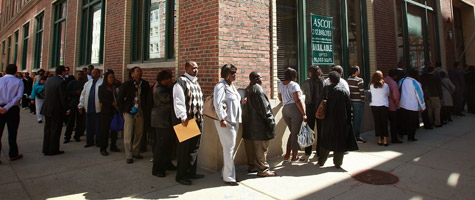 Job seekers wait in line for a job fair in June in Chicago, Ill.  (Scott Olson/Getty Images)