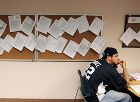 A job seeker sits near the employment bulletin board the New York State Labor Department's Division of Employment Services resource room on July 2, 2009 in the Brooklyn borough of New York City. (Chris Hondros/Getty Images)