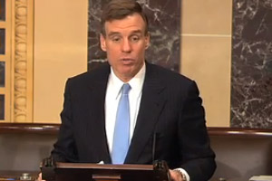 Sen. Mark Warner speaking on the Senate floor about his amendment to fix gaps in how the federal government tracks stimulus spending. (Courtesy of the Web site of Sen. Mark Warner)