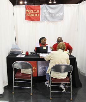 Wells Fargo employees help homeowners go over paperwork during a free workshop in Oakland, Calif., in April. (Justin Sullivan/Getty Images file photo)