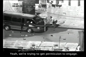 In this screenshot of the WikiLeaks video, the helicopter crew requests permission to fire upon an unmarked van.