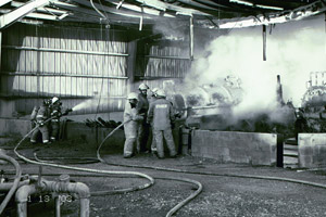 Firefighters extinguish the blaze after an explosion ripped through an injection well site in Rosharon, Texas, on Jan. 13, 2003, killing three workers. (Photo courtesy of the Chemical Safety Board)
