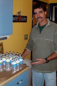 Big Flats, N.Y, resident Joseph Todd turned to bottled water after his well water suddenly turned murky and smelly, shortly after gas drilling began. (Peter Mantius/<a href='http://dcbureau.org/index.php' _cke_saved_href='http://dcbureau.org/index.php'>DCBureau.org</a>)