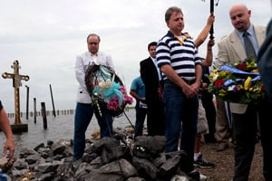 St. Bernard Parish President Craig Taffaro, far right, laying a wreath during the five-year Hurricane Katrina anniversary memorial ceremony at Shell Beach, La., on Aug. 29, 2010. Chairman of the St. Bernard Parish Council Wayne Landry is directly to Taffaro's right in the striped shirt. (Melanie Burford/Prime for ProPublica)