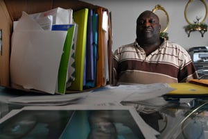 Larry Hall of Wilmington, N.C., sits with boxes of documents, letters and photographs documenting his problems with dialysis treatments over the years. (Gary Allen/ProPublica)