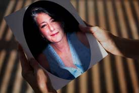 Judy Robins holds a portrait of her sister Dorothy 'Jeanie' Rising, who died in July 2006 of cancer. One of Rising's caregivers, Carolyn Claeys, was found passed out, high on drugs, in Rising's apartment a day after she died. Claeys admitted to authorities that she had stolen Rising's painkillers and injected them. (Liz O. Baylen/Los Angeles Times)