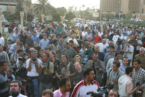 The crowd, comprised mostly of photographers and cameramen, around the base of the Saddam Hussein statue in Baghdad's Firdos Square before it was torn down on April 9, 2003. (Photo by Bryan Mangan)