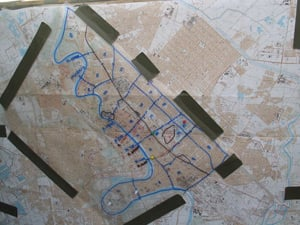 The 27-zone Baghdad map used by Marine Regimental Combat Team 7. Six thumbtacks mark key targets, one of which is the Palestine Hotel. (Photo courtesy of John Schaar)