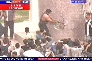 In a much photographed moment, a weight lifter swings a sledgehammer against the base of the Saddam statue in Firdos Square on April 9, 2003. (Sky News)
