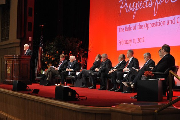 From left to right: Former Attorney General Michael Mukasey (at podium); former Congressman Patrick Kennedy; Bernstein; former Vermont Governor Howard Dean; former House Speaker Dennis Hastert; former New York City Rudy Giuliani; retired General Henry Shelton; retired General George Casey; former FBI director Louis Freeh; retired Lieutenant General David Deptula