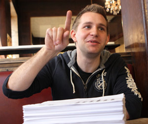 Austrian law student Max Schrems speaks with the 1,222 pages of his Facebook data in front of him. (Dieter Nagl/AFP/Getty Images)