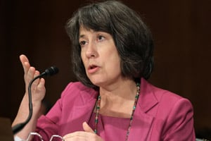 Regulator Sheila Bair warned the Fed: Banks are too fragile to let them return money to shareholders. (Alex Wong/Getty Images)