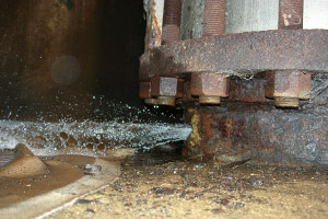 Water shoots out of a rusty pipe at the Byron nuclear plant. (Photo courtesy of the NRC)