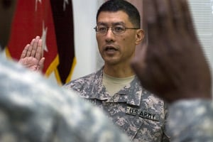 Brig. Gen. Joseph Caravalho, reaffirms his oath as an officer on July 28, 2008, following his promotion to his current rank at the Al-Faw Palace, Camp Victory, Baghdad. (Staff Sgt. Jeremy D. Crisp)