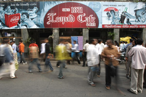 Pedestrains walk past Leopold Cafe, the first target of the Islamist attacks in Mumbai, India, on Nov. 30, 2008. (Sajjad Hussain/AFP/Getty Images)