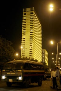Police vehicles patrol as the ongoing security operation continues outside the Oberoi Trident Hotel in Mumbai, India, on Nov. 27, 2008. (Sajjad Hussain/AFP/Getty Images)
