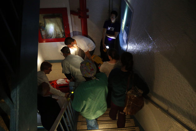 Hospital workers evacuate a patient from NYU Langone Medical Center during Hurricane Sandy on Oct. 29, in New York City. (Michael Heiman/Getty Images)