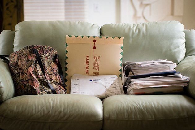 Carla Muss-Jacobs has stacks of paperwork and bills from her knee surgeries.