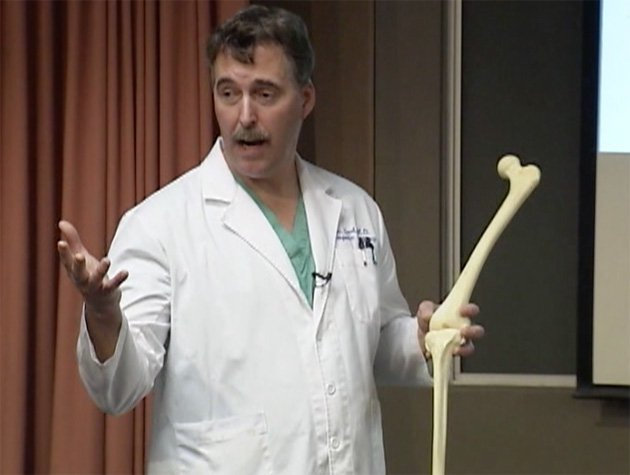 Surgeon Ronald Teed, shown in a screenshot taken from a video of an informational presentation, describes the advantages of the OtisKnee. (Tuality Healthcare)