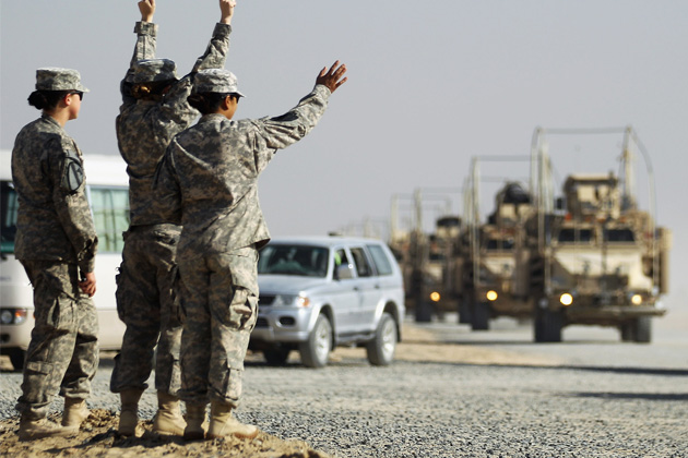 A section of the last American military convoy to depart Iraq from the 3rd Brigade, 1st Cavalry Division arrives in Kuwait in 2011. (Mario Tama/Getty Images)