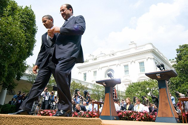 President Obama and Iraqi Prime Minister Nouri al-Maliki leave a joint press conference in the Rose Garden at the White House in 2009. (Saul Loeb/AFP/Getty Images)
