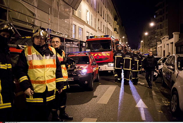 French firefighters are shown after the coordinated terrorist attacks in Paris in November 2015. (Lewis Joly/Sipa via AP)