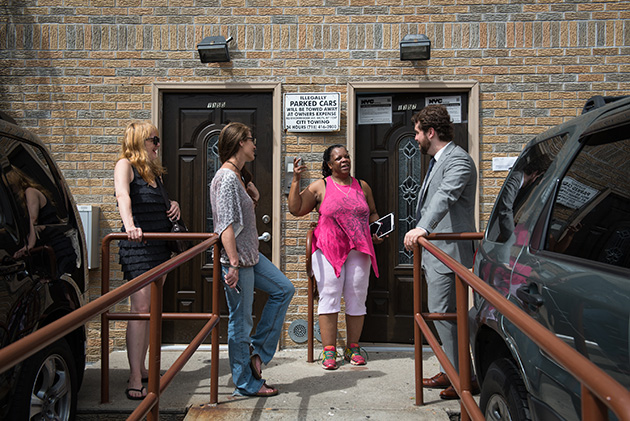 Tenants of 1355 and 1357 Decatur Street talk with their attorney, Raphael Ruttenberg. (Edwin J. Torres for ProPublica)