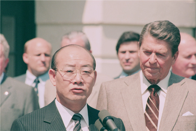 Former South Korean President Chun Doo-hwan addresses the press at the White House in 1985. Chun's relatives later gained permanent residency in the United States by using money Chun obtained through bribes. (Bettmann via Getty Images)