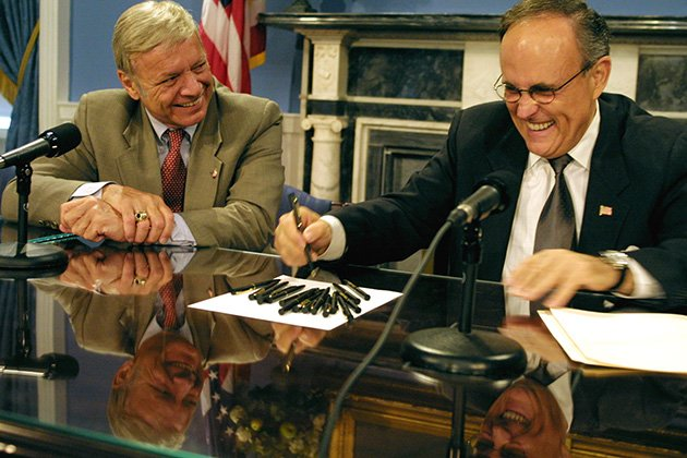 Then-Council Speaker Peter Vallone, left, and New York City Mayor Rudolph Giuliani during a bill signing in 2001 (AP Photo/Diane Bondareff)