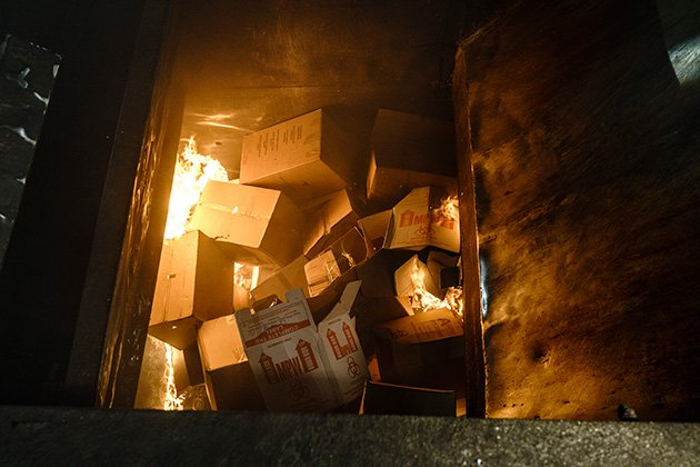 Boxes of unused drugs burn in the opening of an incinerator at Curtis Bay Medical Waste Services in Baltimore, Maryland. (Matt Roth for ProPublica)