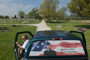 Jim and Cindy Butler visit the grave of their son Jake on the ninth anniversary of his death in Iraq. (Steve Hebert for ProPublica)