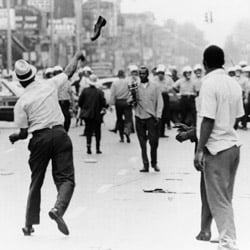 A man hurls a shoe at Detroit police on July 23, 1967. Then-Michigan Gov. George Romney was profoundly affected by the riots and worked for housing integration during both his governorship and while secretary of the Department of Housing and Urban Development in the Nixon administration. (AP Photo)
