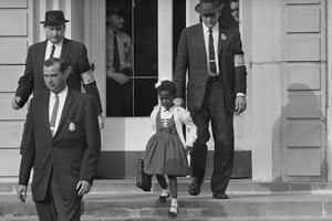 U.S. Deputy Marshals escort Ruby Bridges from William Frantz Elementary School in New Orleans, La., in November 1960. (AP Photo)