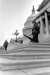 U.S. troops stand guard on the steps of the Senate wing of the Capitol Building in Washington, D.C., on April 5, 1968. Armed National Guardsmen were again called in a few days later as Congress passed Title VIII of the 1968 Civil Rights Act, commonly known as the Fair Housing Act. (AP Photo)