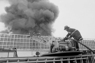 Brooklyn firefighters climb to the roof of a Waldbaum's supermarket in Brooklyn, N.Y., on Aug. 2, 1978. Minutes later, the roof collapsed, killing six firefighters. Eric Jackson-Knight was tried and convicted of setting the fire in 1980. Eight years later, a state appeals court overturned the conviction. (AP Photo)