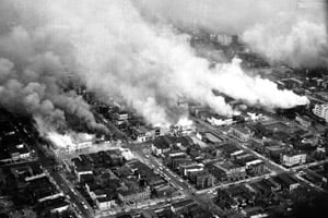Clouds of smoke rise from burning buildings in northeast Washington, D.C., on April 5, 1968, one day after Dr. Martin Luther King Jr. was assassinated. Then-Sen. Mondale recalled flying over the nation's capital in a helicopter thinking it looked like Vietnam. (AP Photo)
