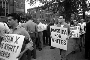 Members of the American Nazi Party march with signs across the street from Chicago's Greater Mount Hope Baptist Church, the site of a meeting between Dr. Martin Luther King Jr. and civil rights workers on Aug. 19, 1966. (AP Photo)
