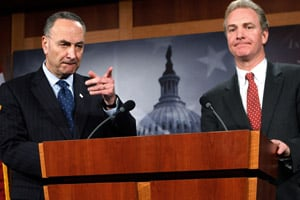 Sen. Charles Schumer, left, and Rep. Chris Van Hollen speak to the media on Feb. 11, 2010. Schumer and Van Hollen plan to introduce a bill aimed at offsetting the recent Supreme Court ruling that allows corporations and unions to use their general funds to run television ads that say outright whether a candidate should be elected. (Alex Wong/Getty Images)