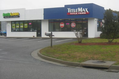When service members ask about title loans at TitleMax, they're directed to InstaLoan, TitleMax's sister company, which provides installment loans. Outside of Fort Stewart in Hinesville, Ga., that's next door.  (Mitchell Hartman/Marketplace)