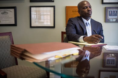 Jabbar Collins in a meeting at the law firm where he now works. Collins was convicted of murder in 1995, but won his release in 2008. (Andrew Burton for ProPublica)