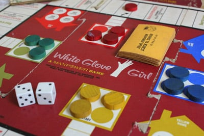 White Glove Girl, a Manpower game made in 1966. The object of the game is to be the first to earn money to afford four goals: children's college education, a vacation, home remodeling and a new wardrobe. (Krista Kjellman Schmidt /ProPublica)